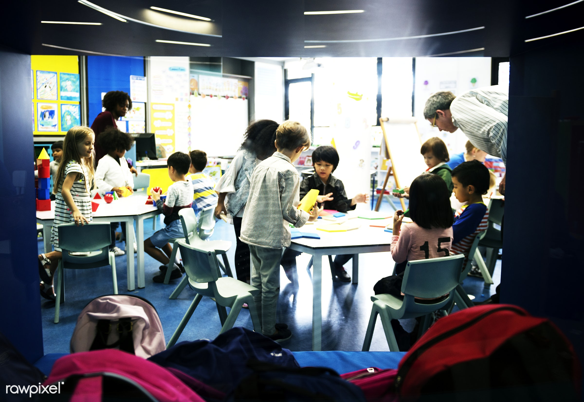Happy kids at elementary school - chairs, children, education, playing, boys, casual, wooden block, girls, students,...