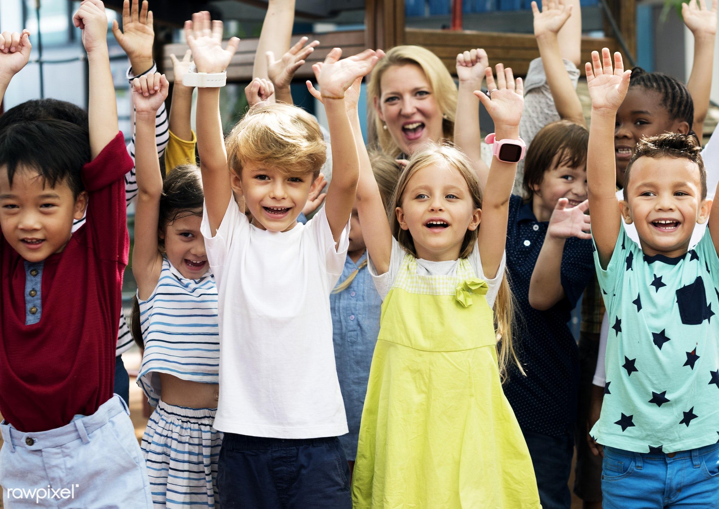 Happy kids at elementary school - school, kindergarten, african, african american, american, arms raised, asian, black,...