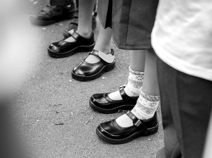 Kids in school uniform standing in line