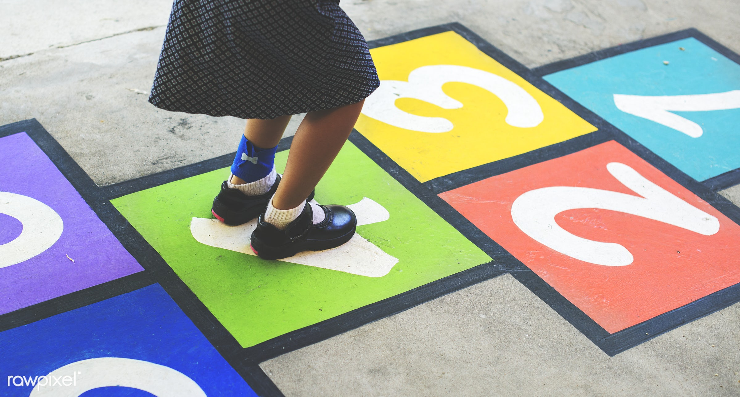 Kid playing hopscotch at school - child, education, elementary, game, girl, ground, hopscotch, jumping, kid, learning, legs...