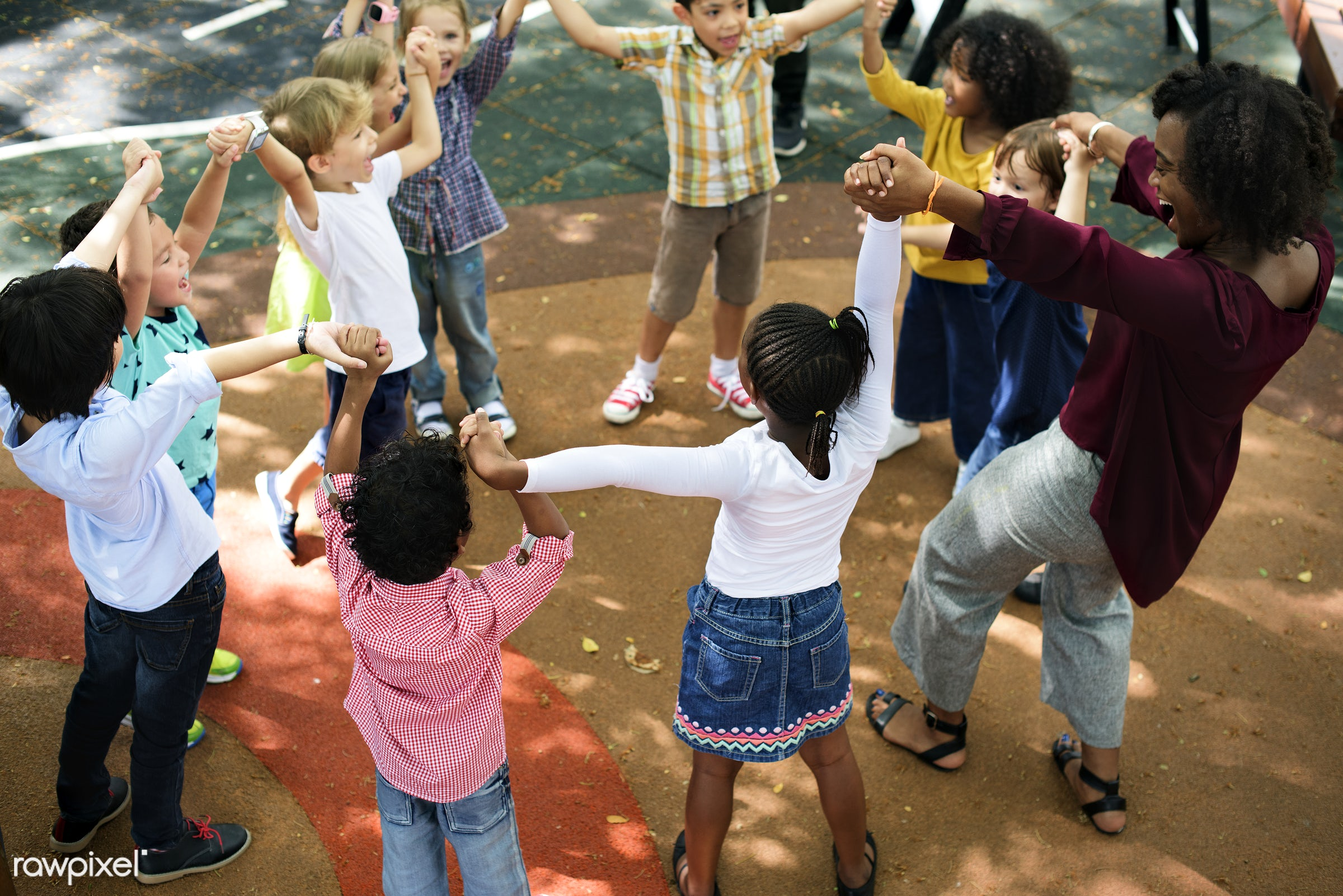 Happy kids at elementary school - daycare, teacher, activity, african, african american, american, arms raised, asian, black...