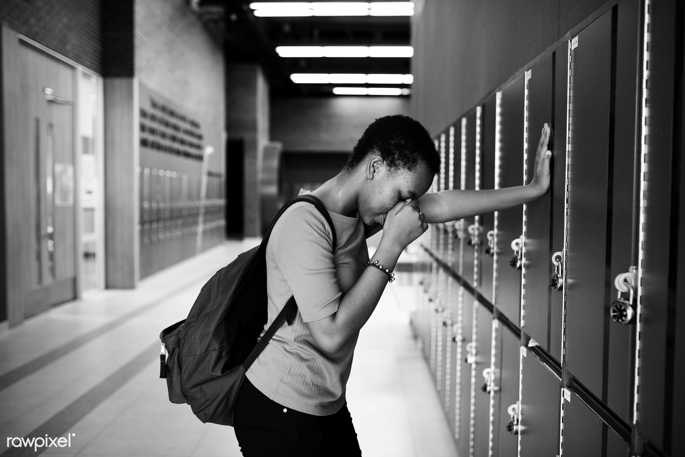 face, person, sad, corridor, girl, student, casual, backpack, alone, lonely, problems, high school, african descent, gesture...