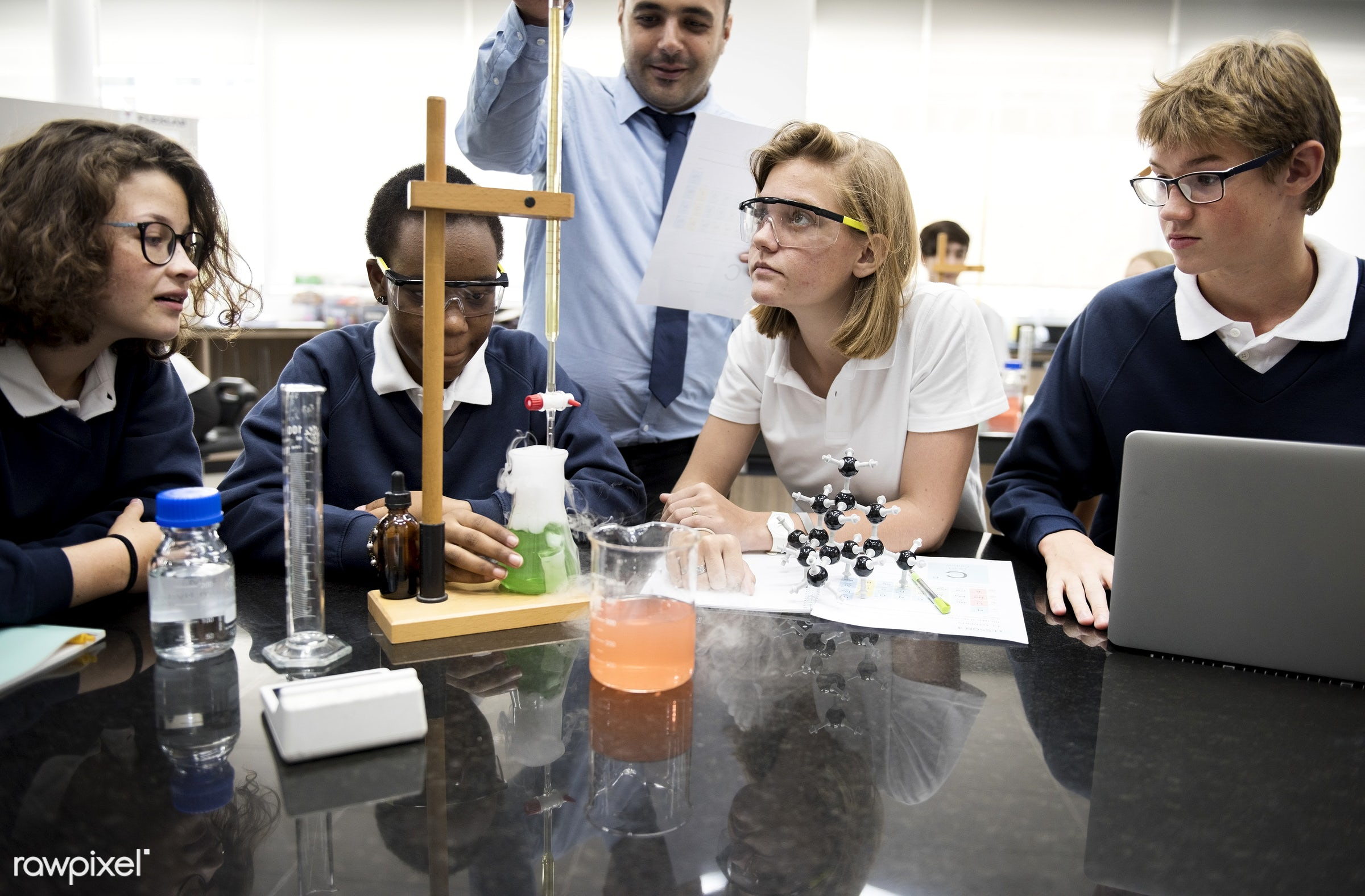 person, using, solutions, goggles, study, people, together, science, young adult, mixing, experiment, laptop, beakers,...