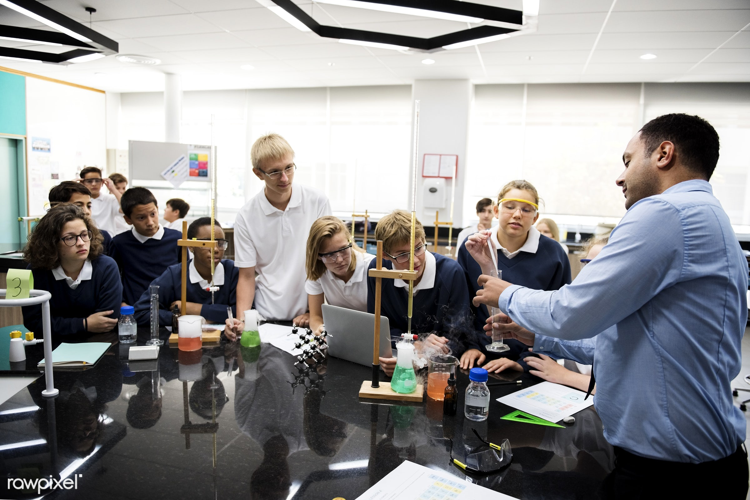 using, person, solutions, goggles, study, people, together, science, young adult, mixing, experiment, laptop, beakers,...