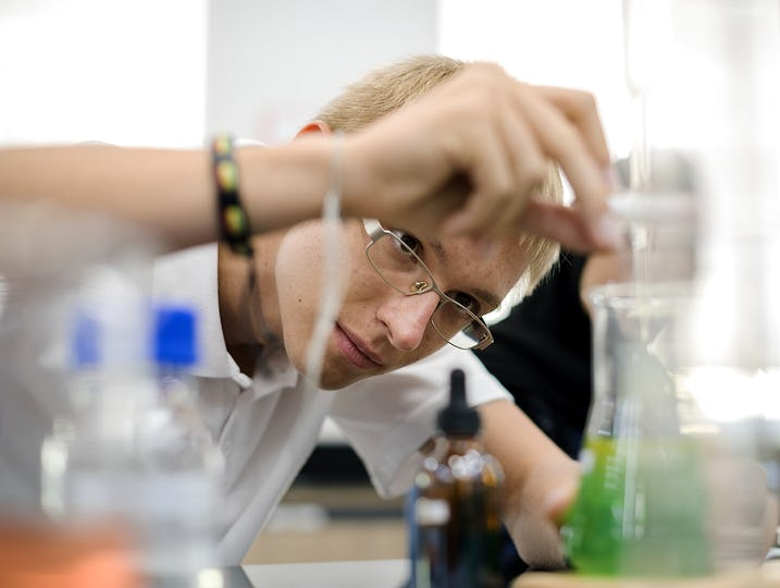Male student doing a science experiment in the laboratory