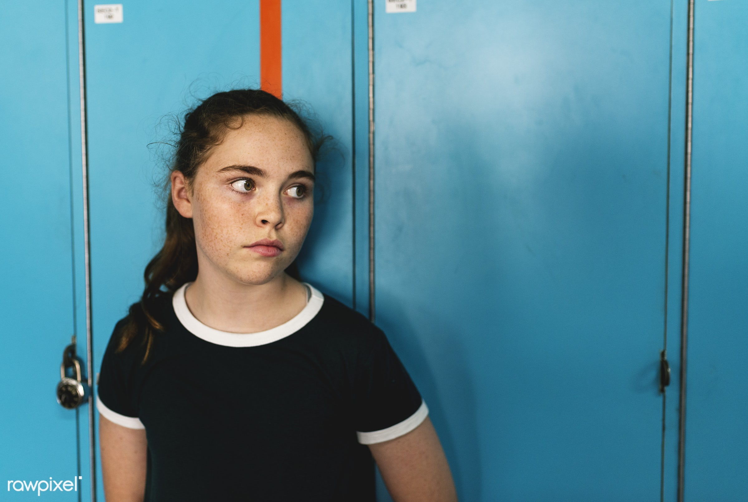 candid, young, caucasian, looking, staring, girl, student, adolescent, casual, freckles, standing, alone, lockers, wide-eyed...