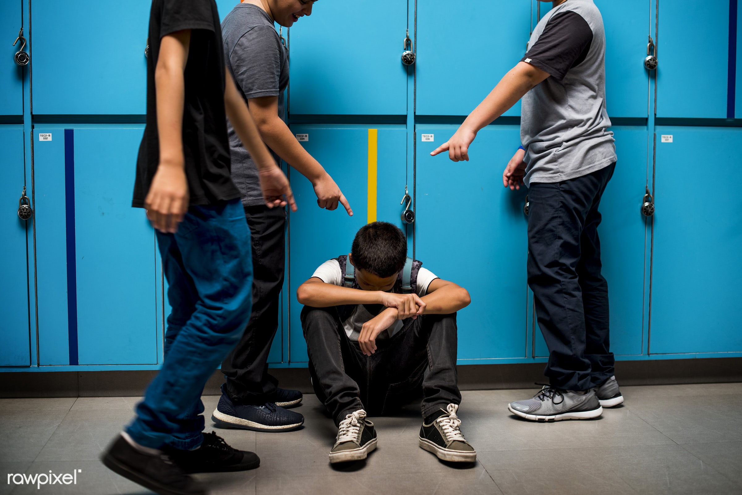 corridor, picked on, asian ethnicity, young adult, teenager, boys, casual, high school, teasing, gesture, locker, harassment...
