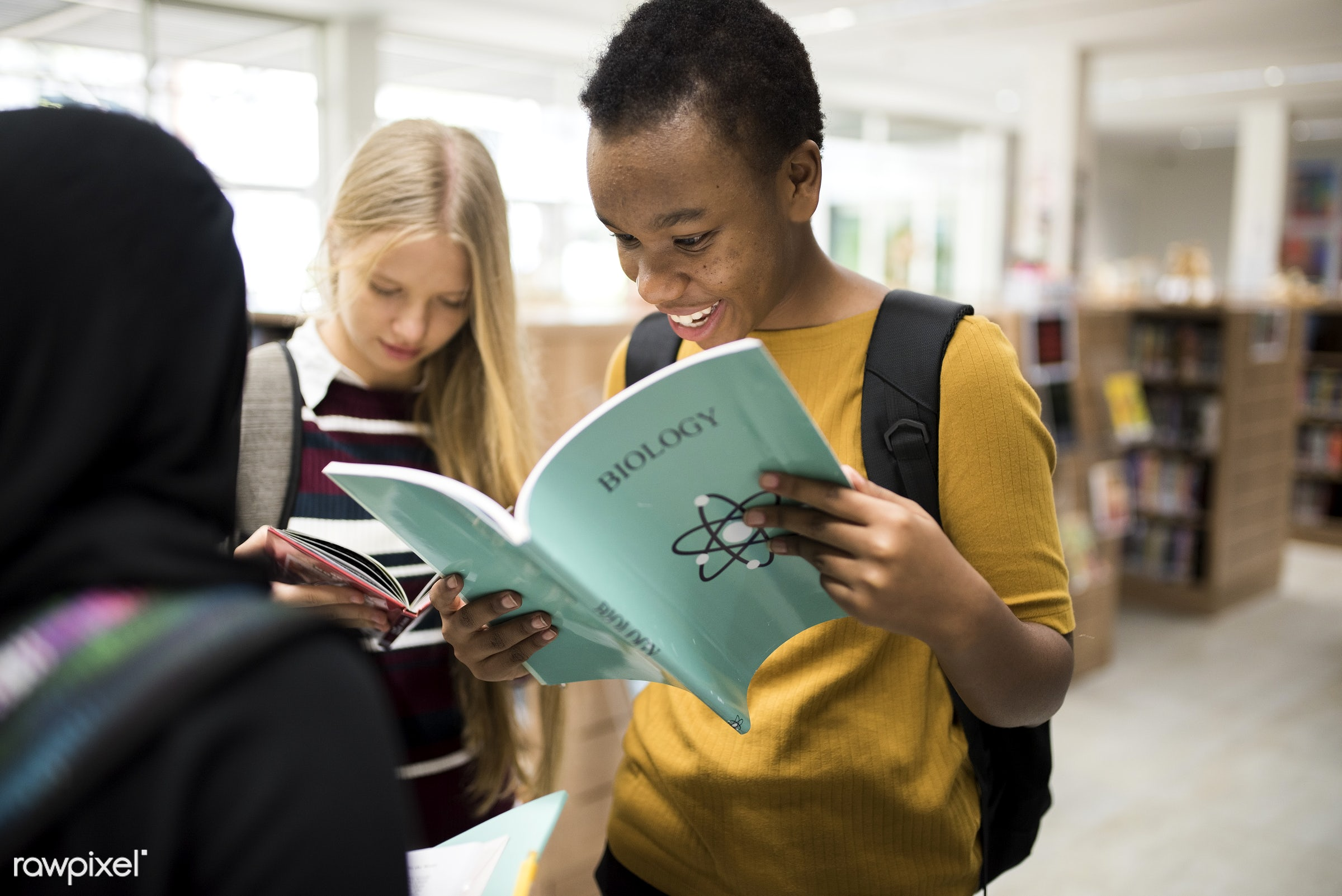 reading, holding, study, together, friends, young adult, hands, bookshelves, books, diversity, students, high school, teen,...