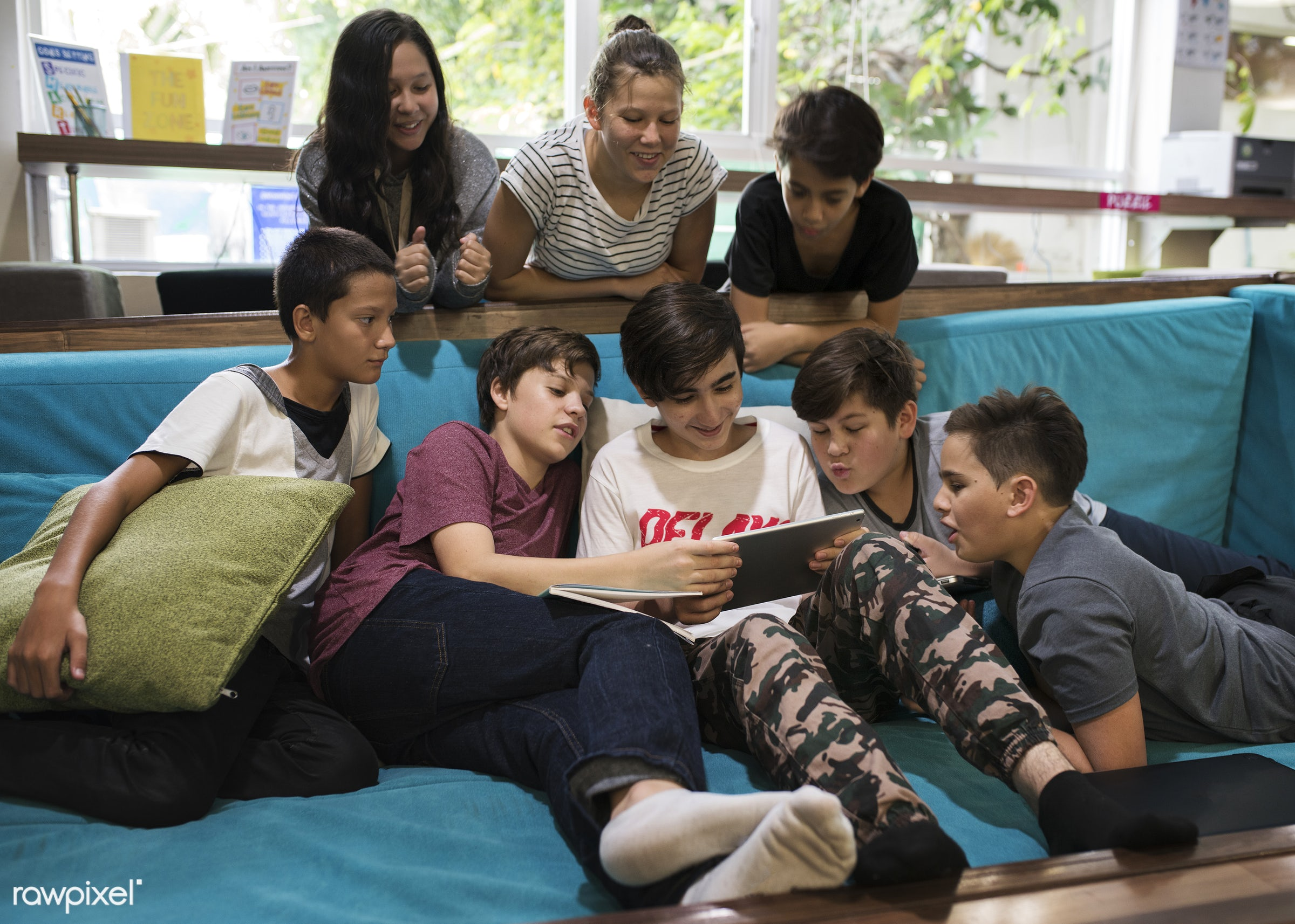 using, pillow, middle school, holding, together, sofa, young adult, watching, hands, casual, students, diversity, high...