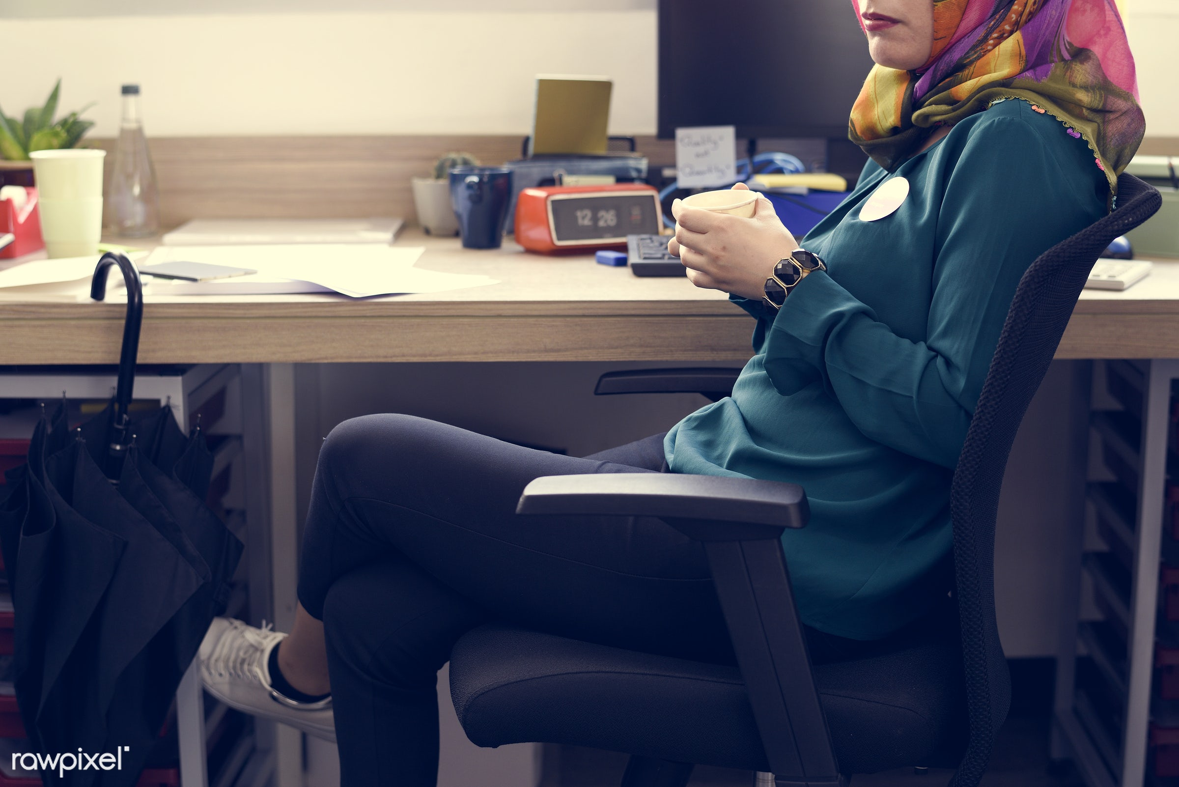 Muslim woman working at the office - business, career, communication, company, computer, connection, desk, hijab, internet,...