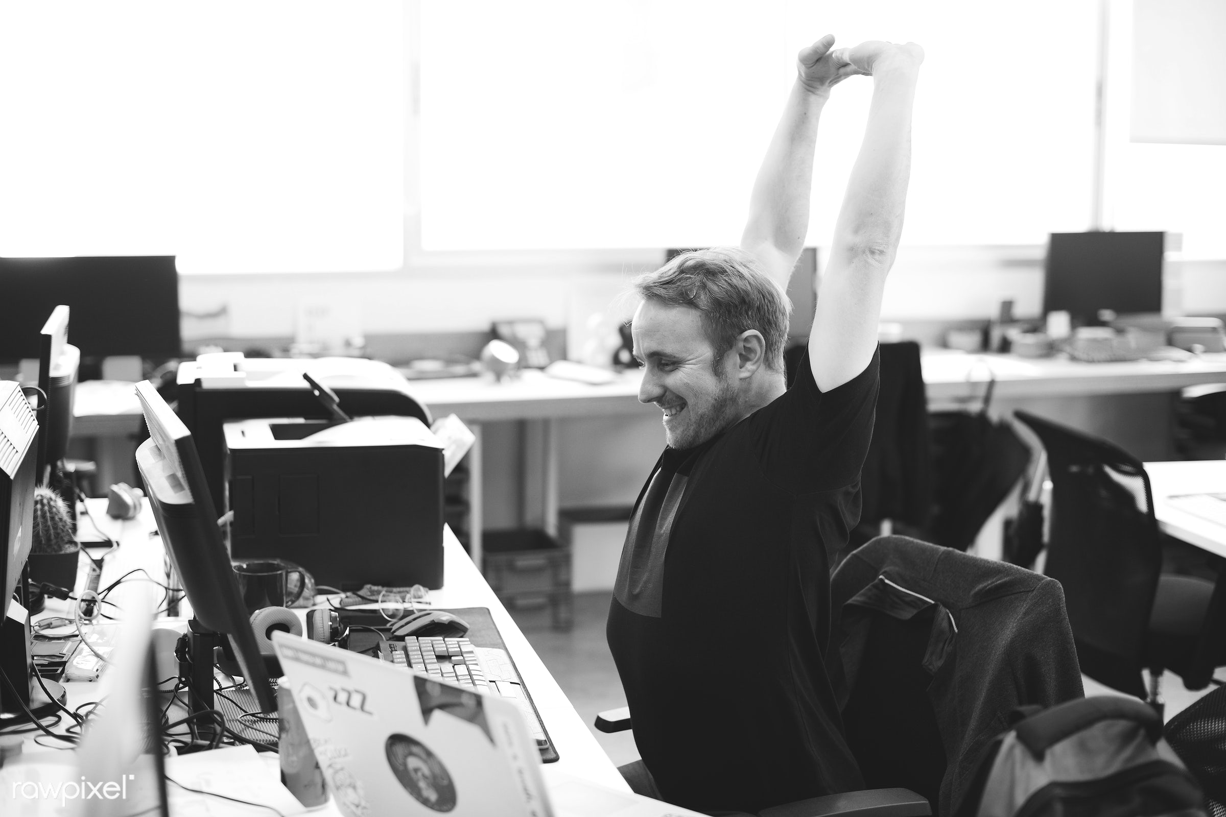 Man stretching arms during break time at office - break, business, career, cc0, communication, company, computer, connection...