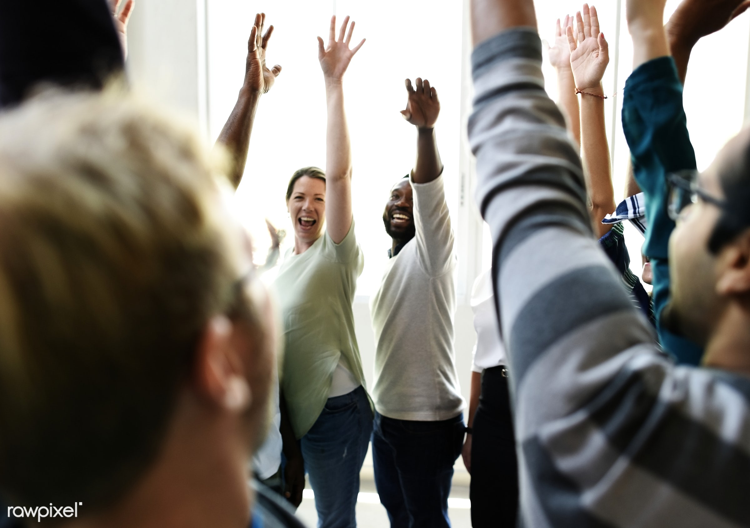 Diversity teamwork with raised hands - african descent, black, brainstorm, business, casual, caucasian, cheerful, cheers,...