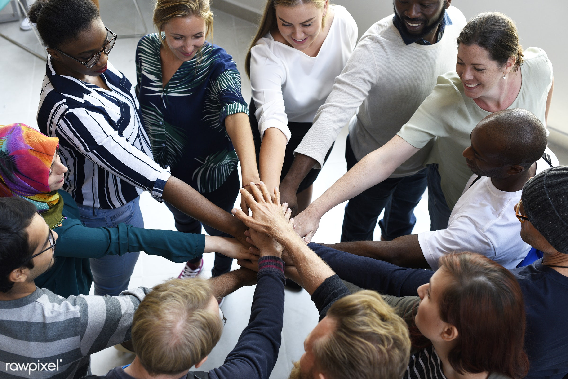 Diversity teamwork with joined hands - performance, african descent, black, brainstorm, business, casual, caucasian,...