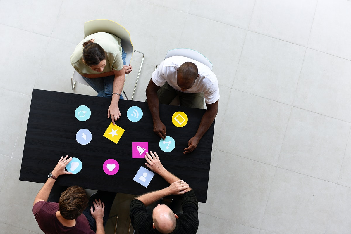 Group of diverse people brainstorming together