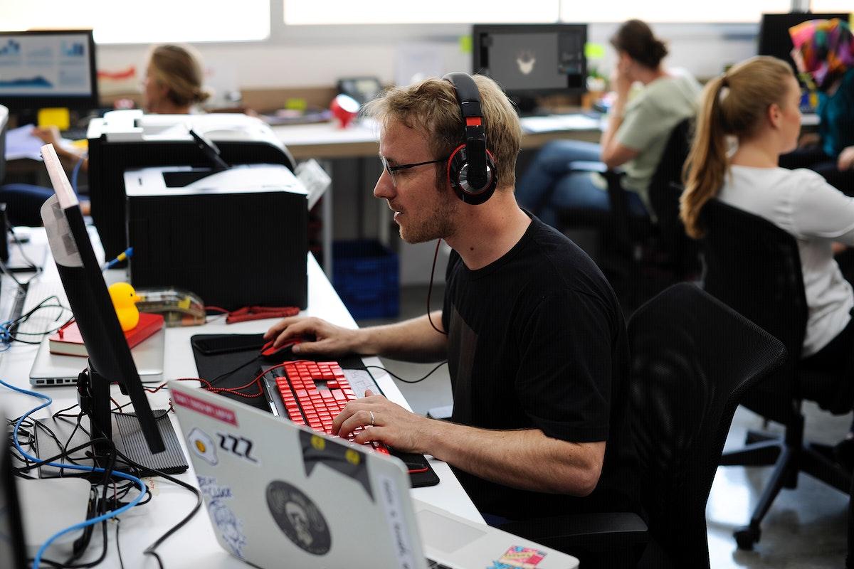 Caucasian man using computer laptop