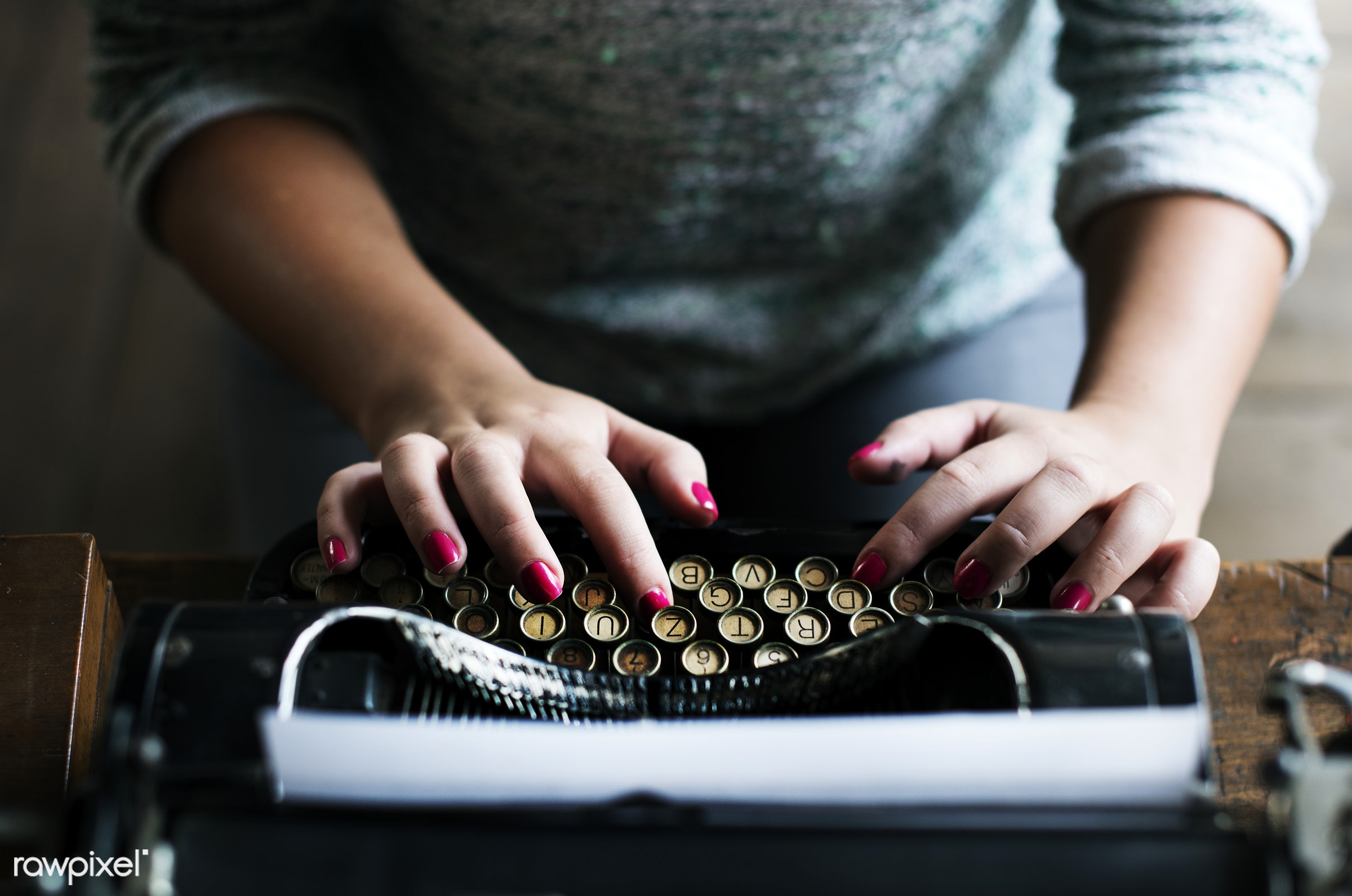 Woman typing on vintage typewriter on wooden table - journalism, person, old, retro, author, typewriter, hands, woman,...
