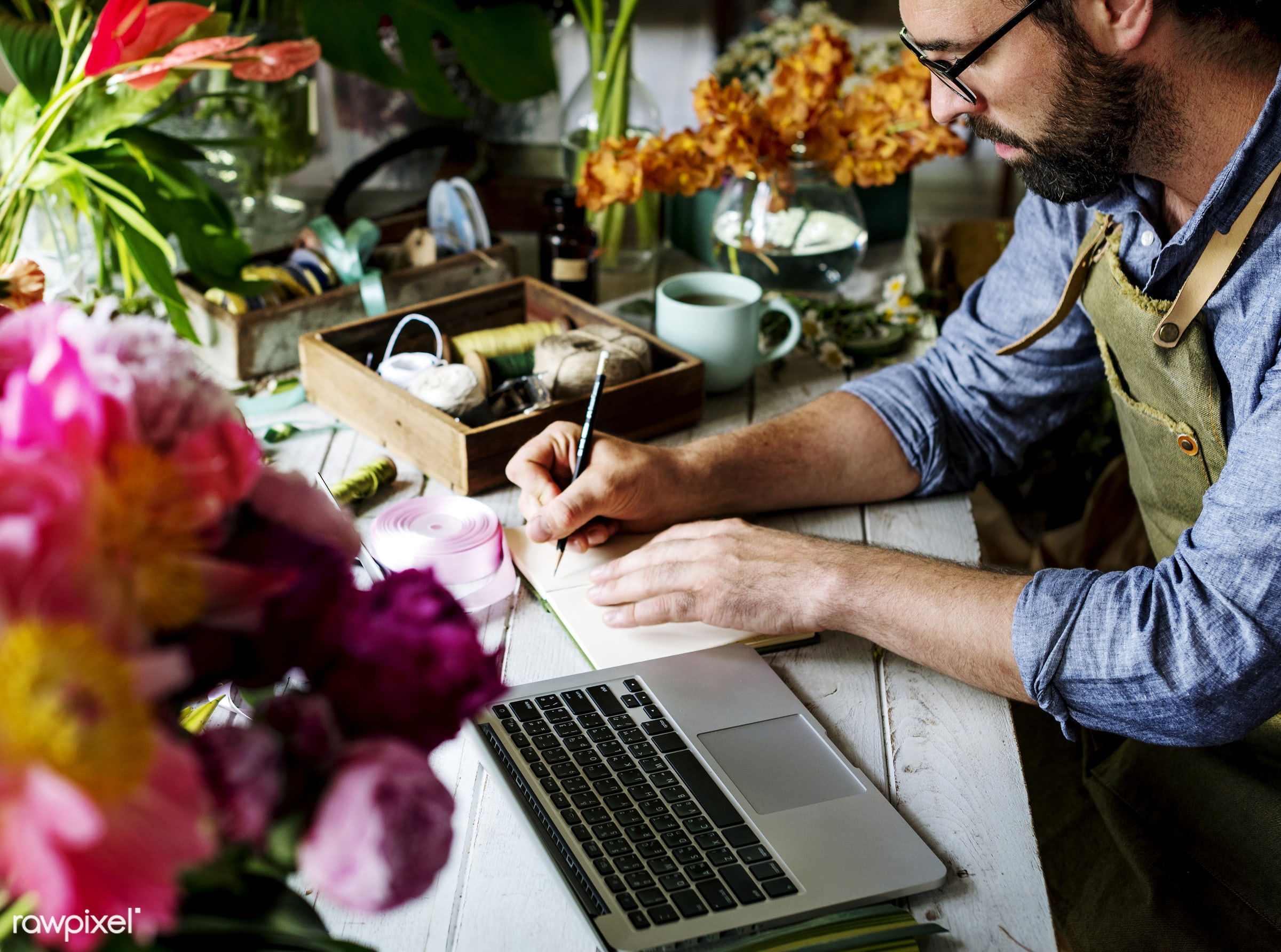 Business owner in his flower shop - bouquet, person, store, small business, indoors, writing, self-employed, business,...