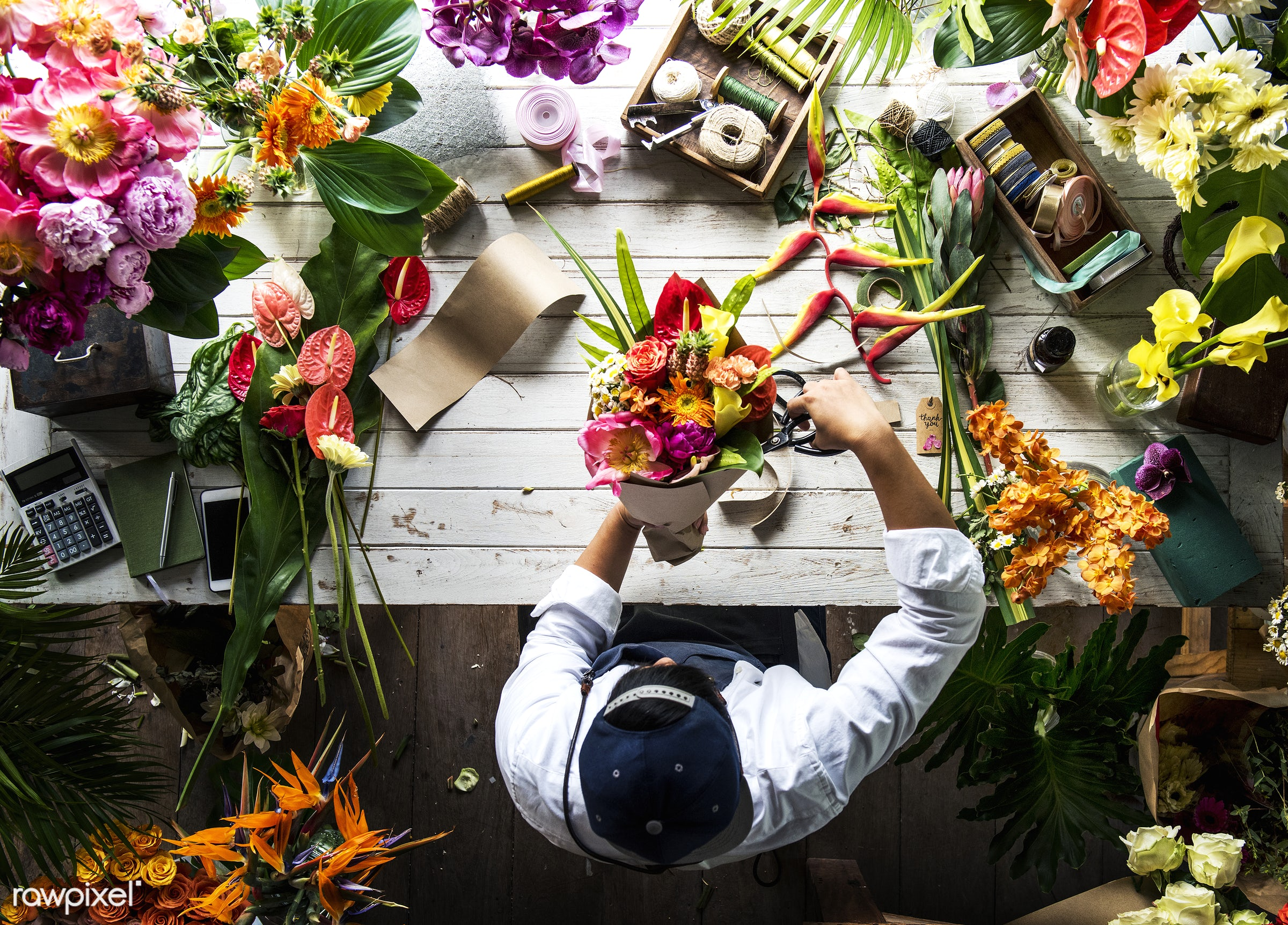 Florist making a flower arrangement in a flower shop - bouquet, person, store, indoors, self-employed, business, nature,...