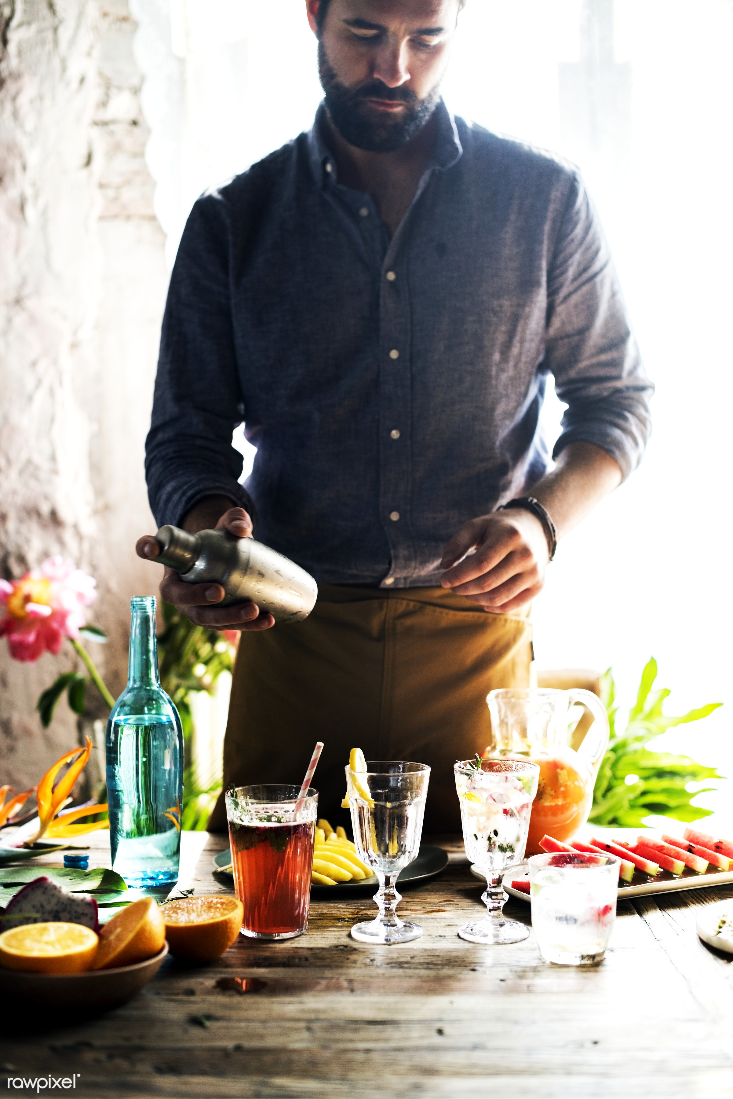 Bartender mixing colorful cocktails - alcohol, bar, barman, bartender, beard, beverage, candid, casual, cocktail, creating,...