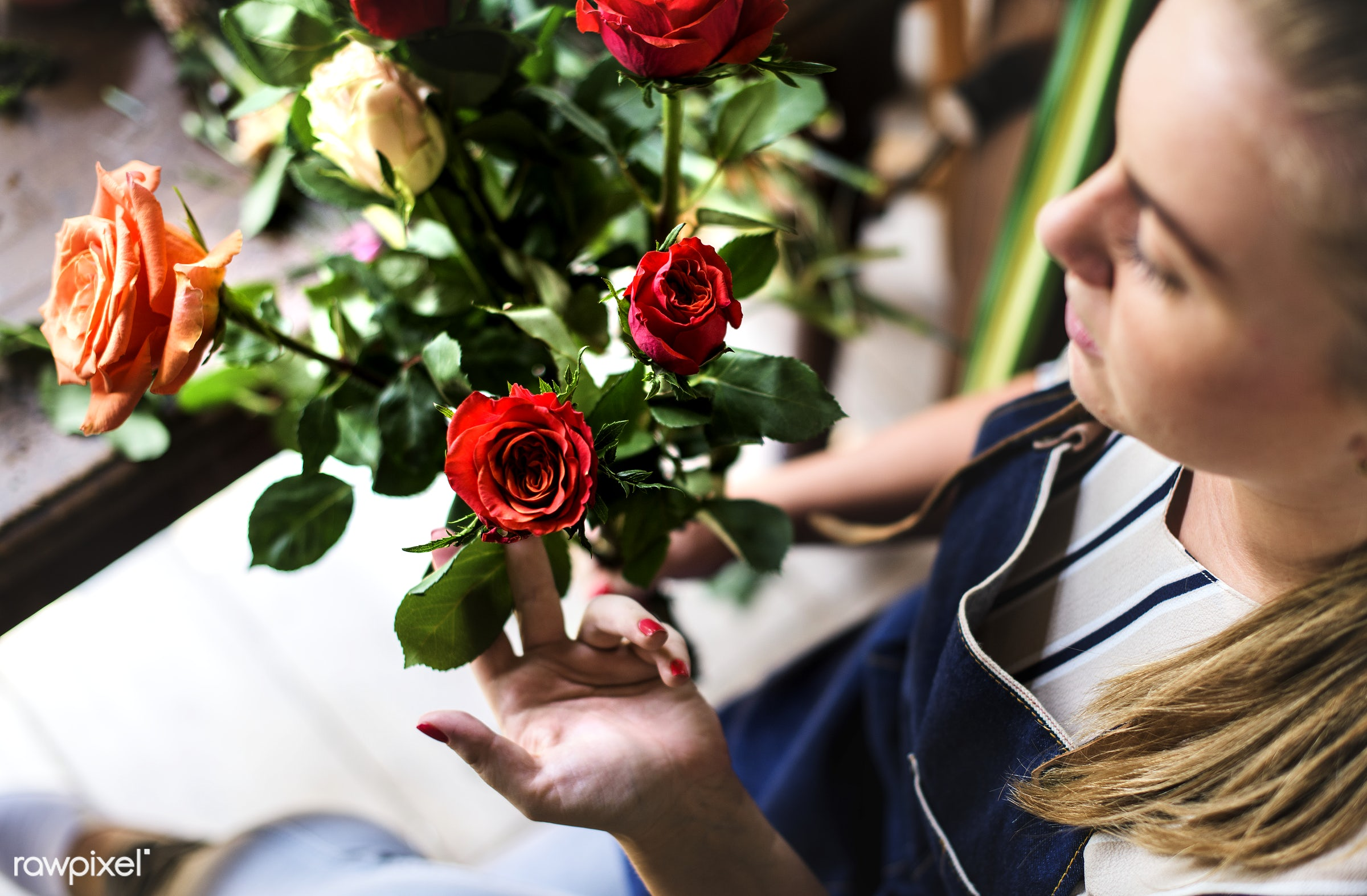 Florist with a rose bouquet - bouquet, person, store, small business, indoors, self-employed, business, nature, hands,...