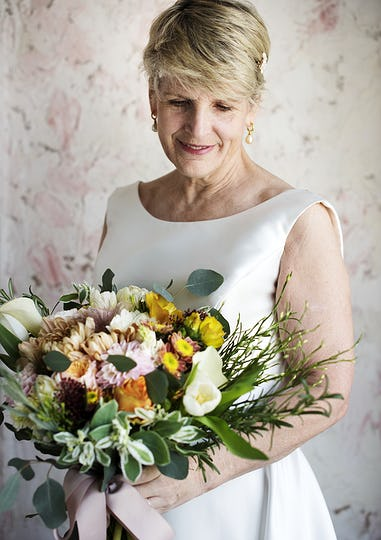 Senior Caucasian Bride Holding Flower Bouquet Wedding Engagement Ceremony