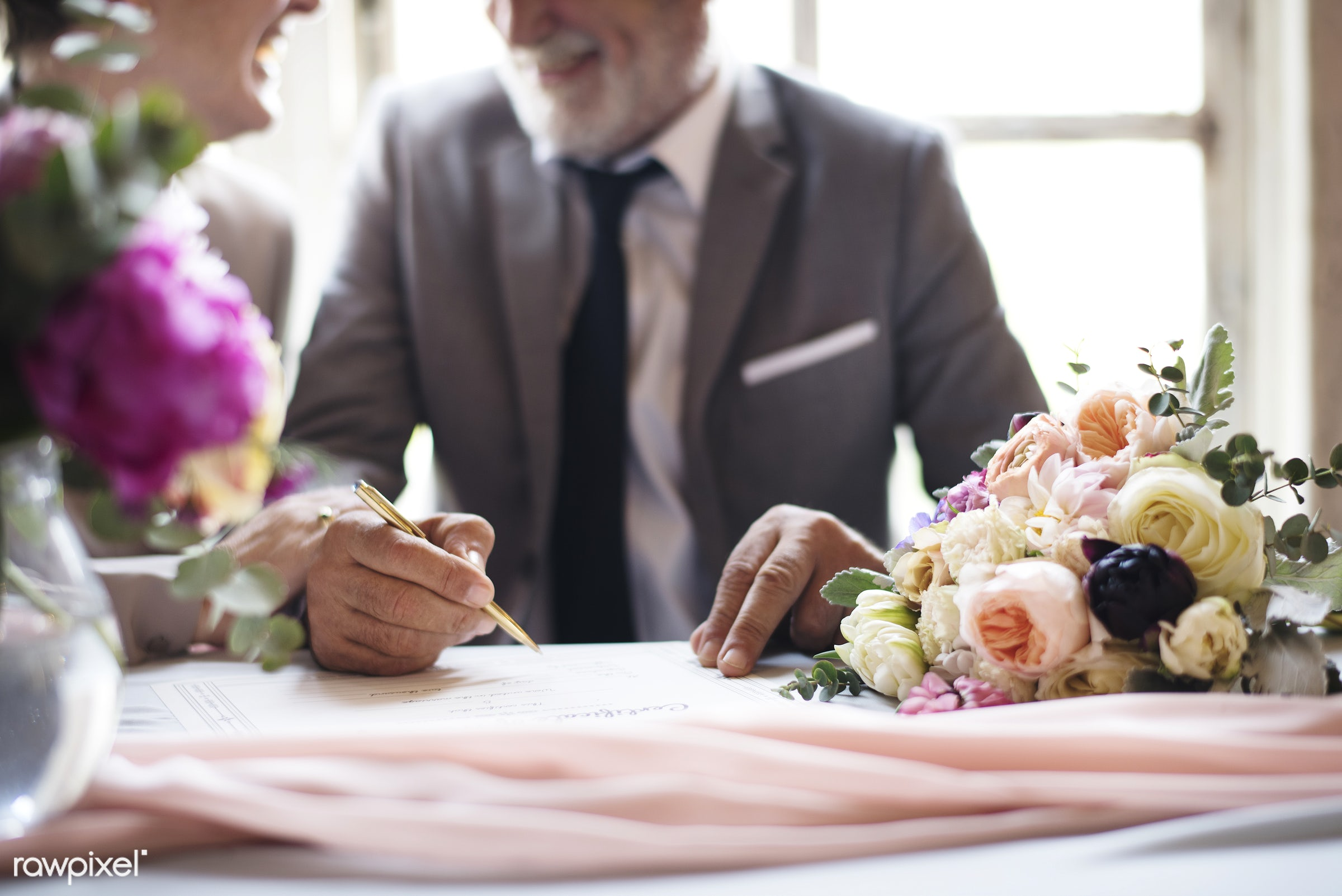 person, holding, paper, smitten, people, together, love, certificate, married, signing, hands, event, couple, flowers,...