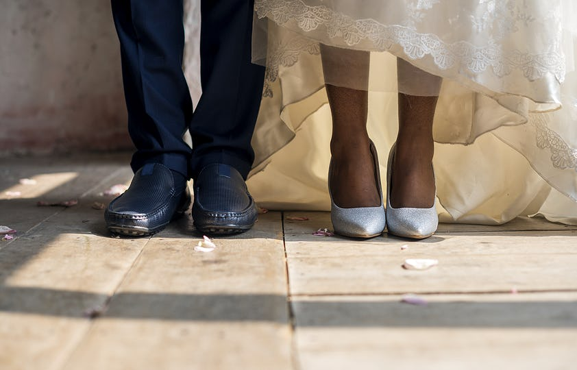 Bride and Groom Feet Standing on Wooden Floor