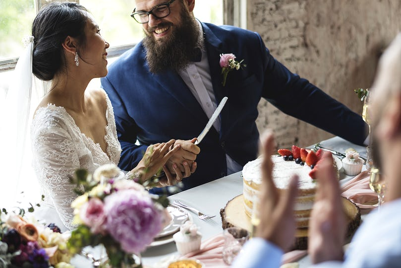 Couple Hands Holding Wedding Cake Knife