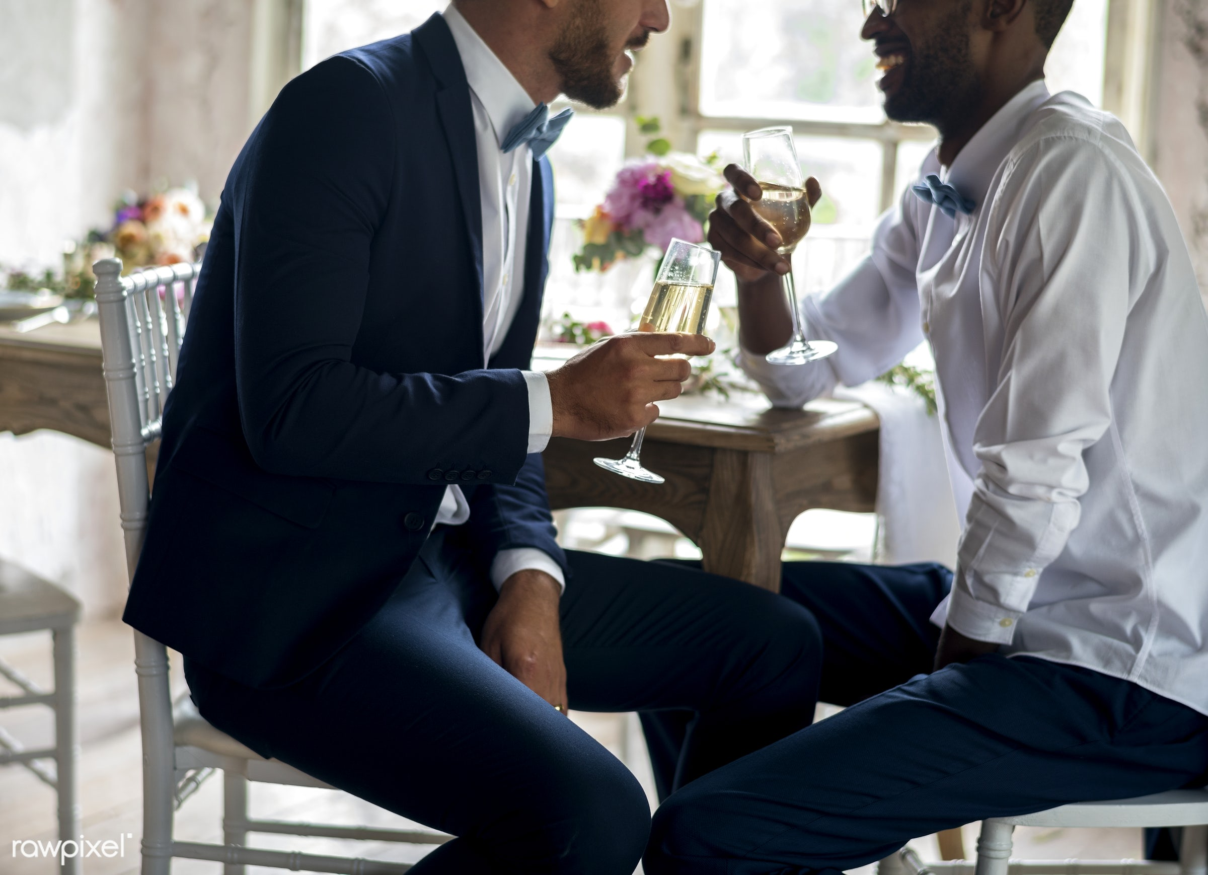 Gay couple having champagne at wedding reception - groom, lgbt, gay, homosexual, marriage, wedding, love, equality, people,...