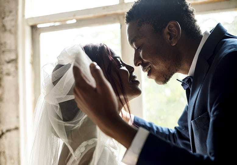 Newlywed African Descent Groom Open Bride Veil Wedding Celebration