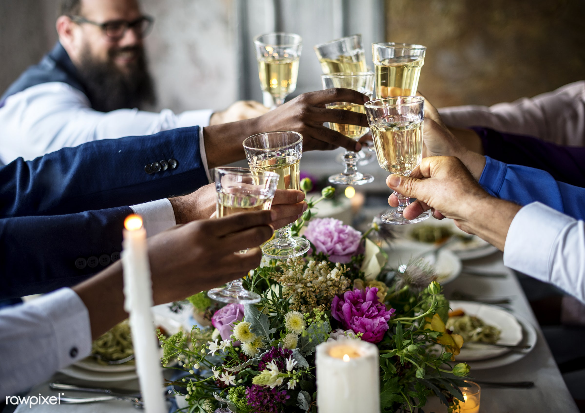 People holding their champagne glasses for a toast at a wedding table - reception, alcohol, celebration, champagne, cheerful...
