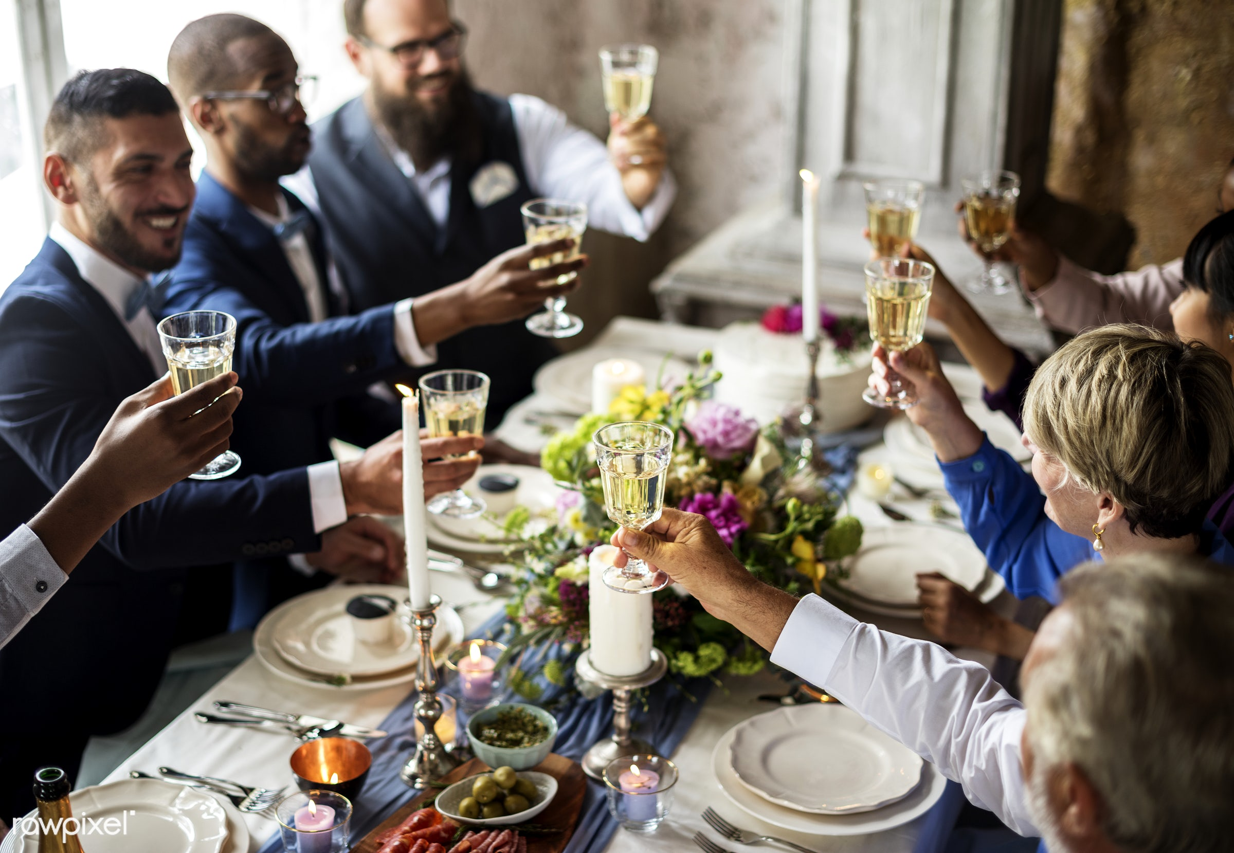 People holding their champagne glasses for a toast at a wedding table - alcohol, celebration, champagne, cheerful, cheers,...