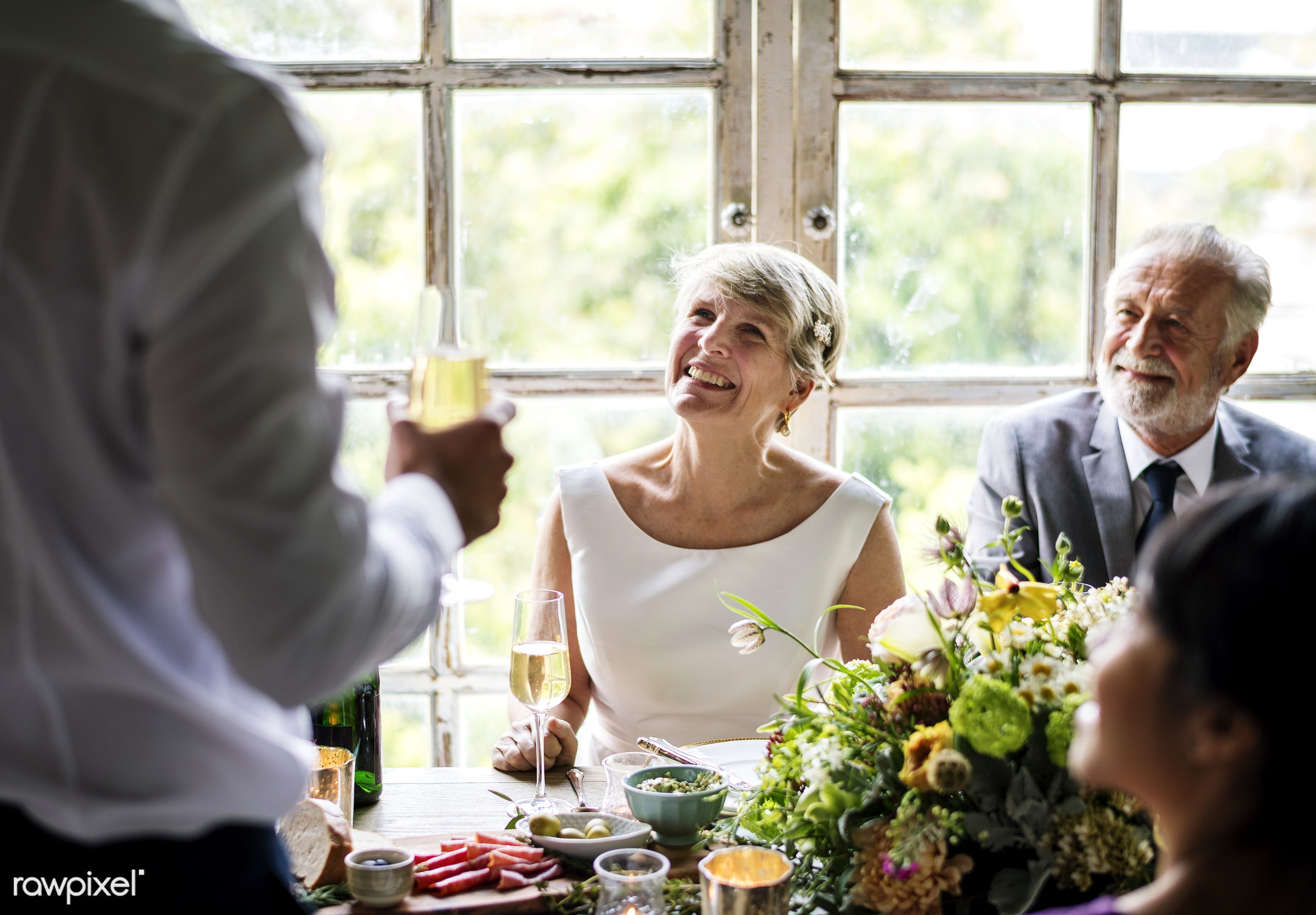 Bridge and groom wedding day - table, listening, toast, speech, champagne, glass, elderly, senior, old, relationship,...