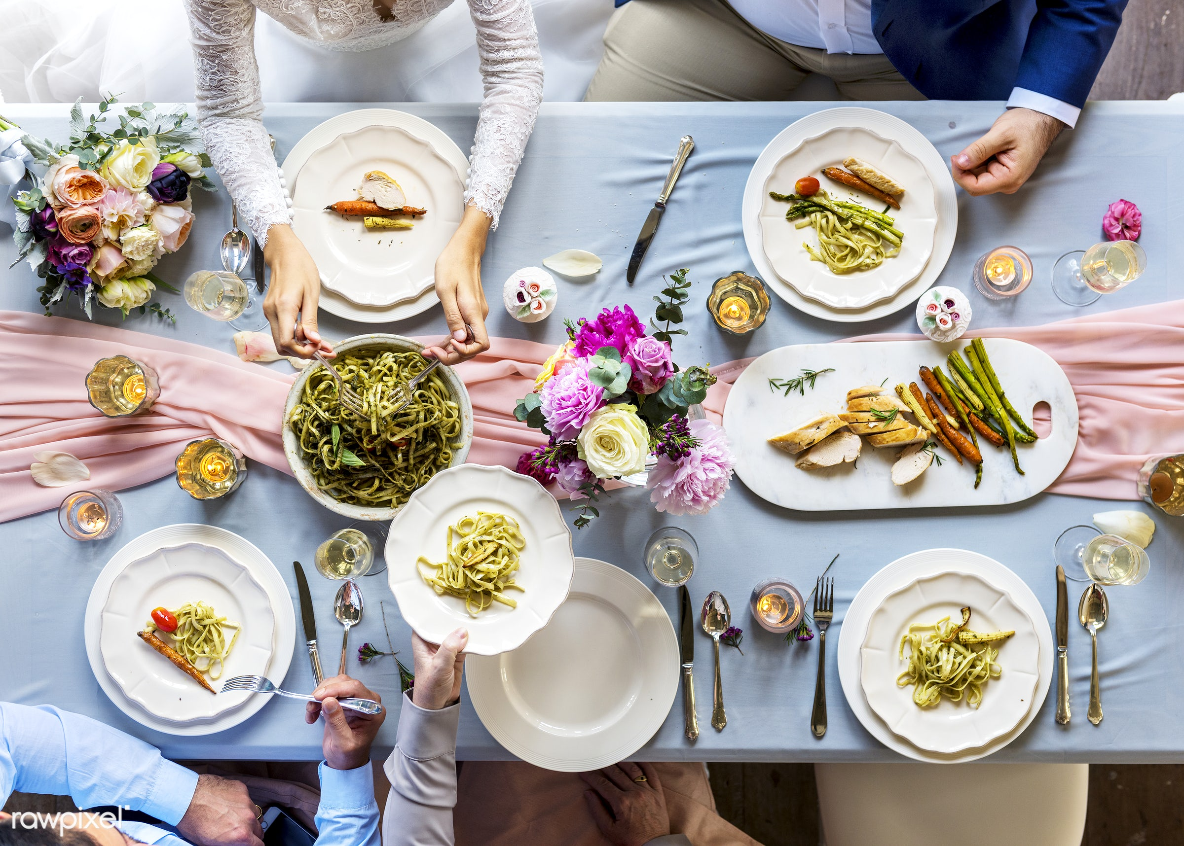 Aerial view of a bridal party dining table - aerial view, celebration, dining, dinner, eating, event, flowers, food,...