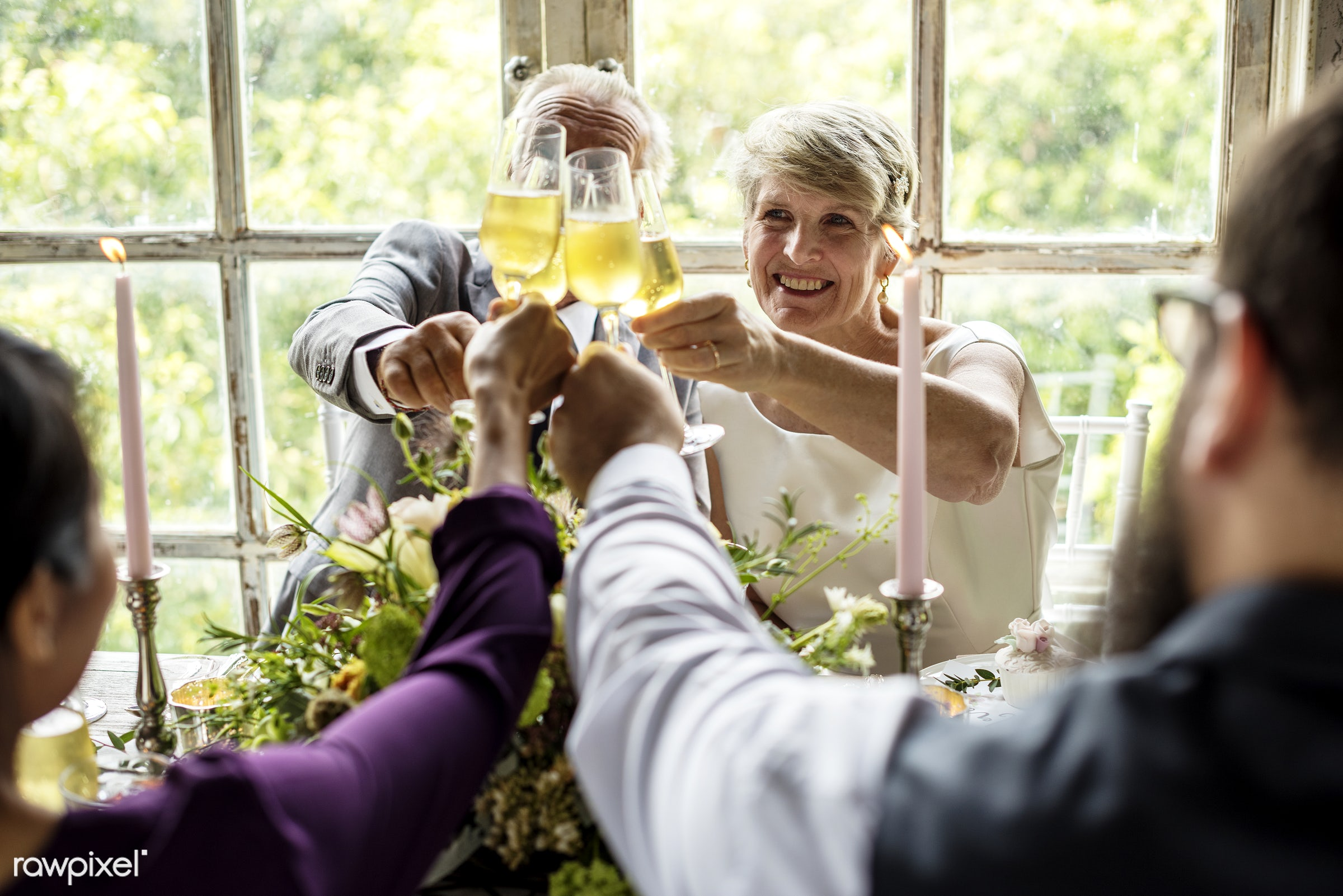Bridge and groom wedding day - smiling, cheerful, enjoying, fun, happiness, old, elderly, senior, table, toast, champagne,...
