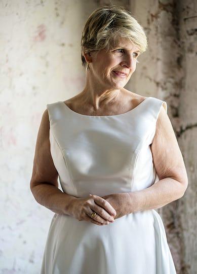 Senior bride in white wedding gown