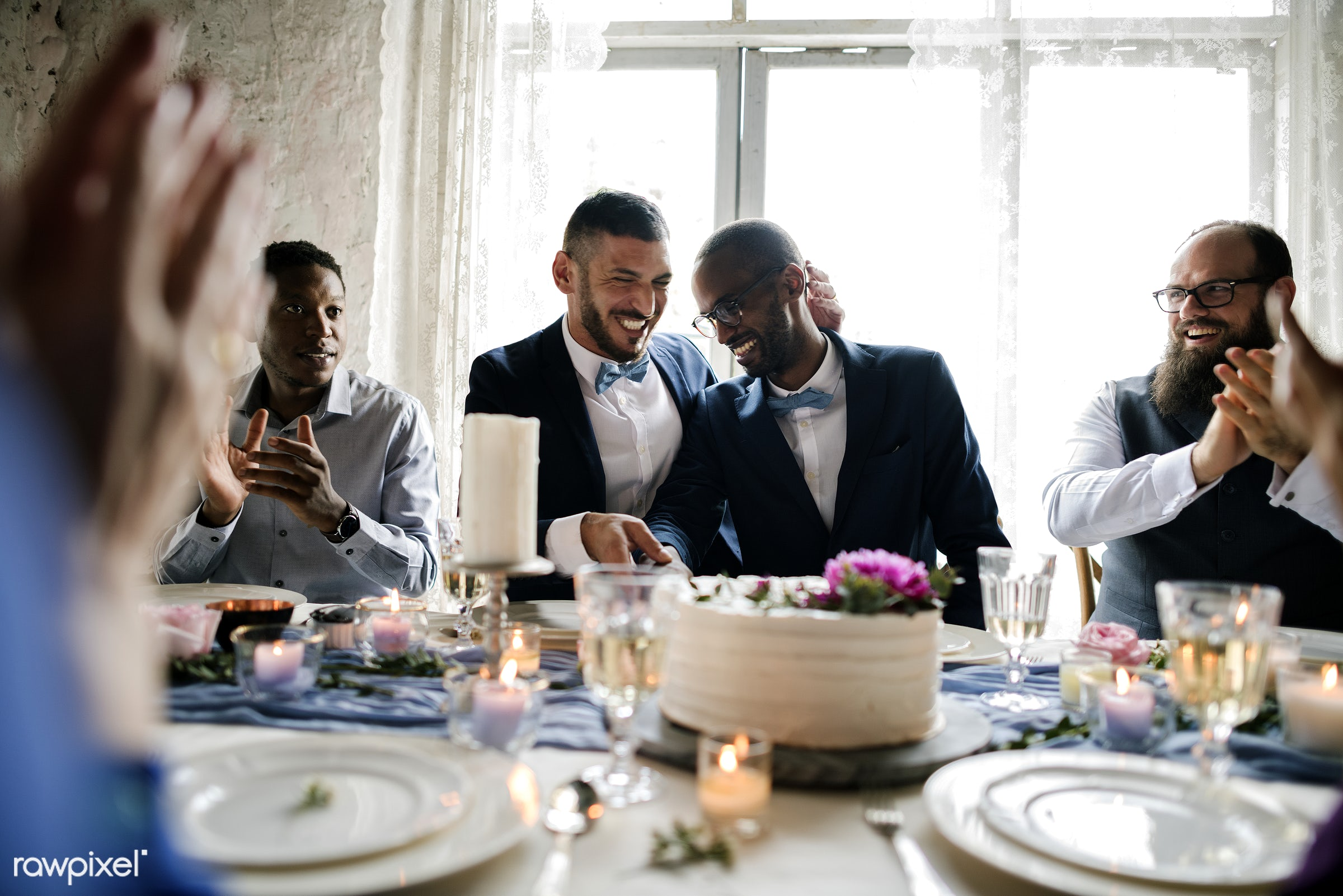 Diverse gay couple newlyweds at reception table - affection, black, cake, celebration, cheerful, couple, dining, dinner,...