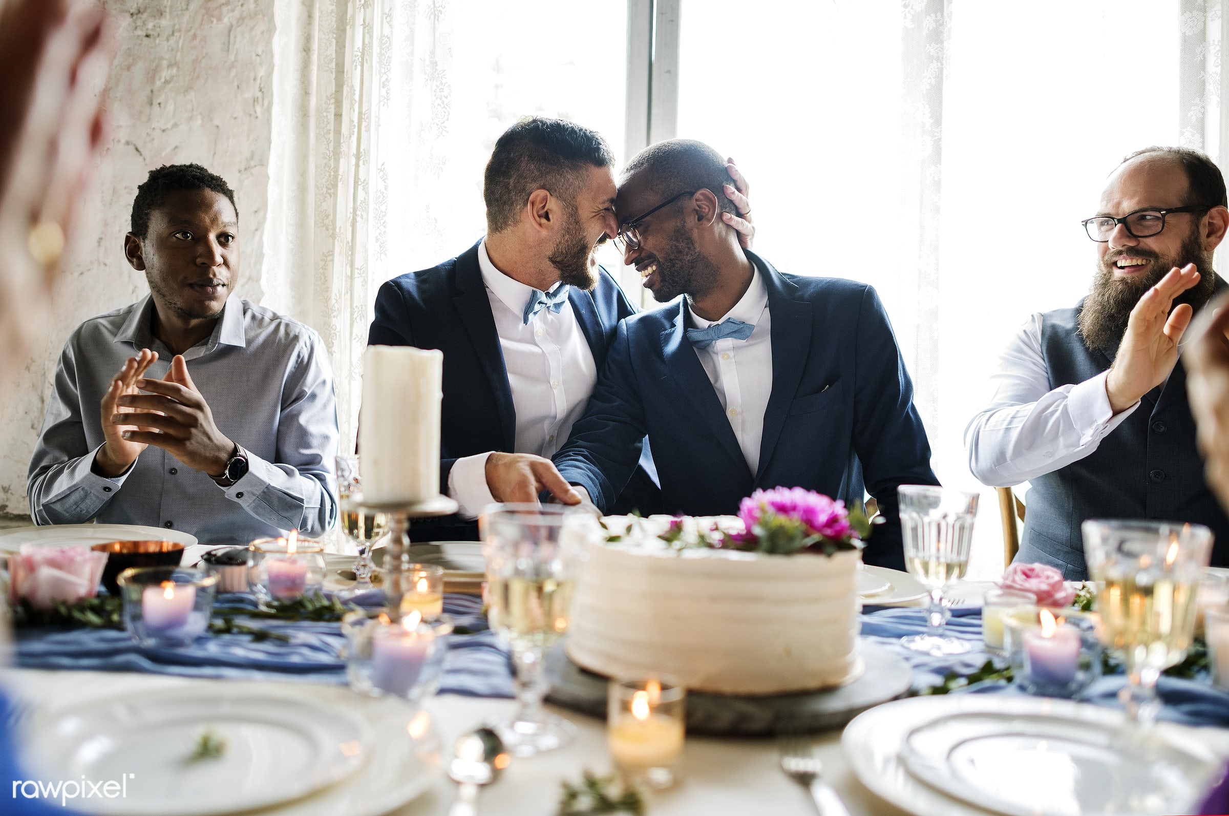 Diverse gay couple newlyweds at reception table - affection, black, cake, celebration, cheerful, closeness, couple, dining,...