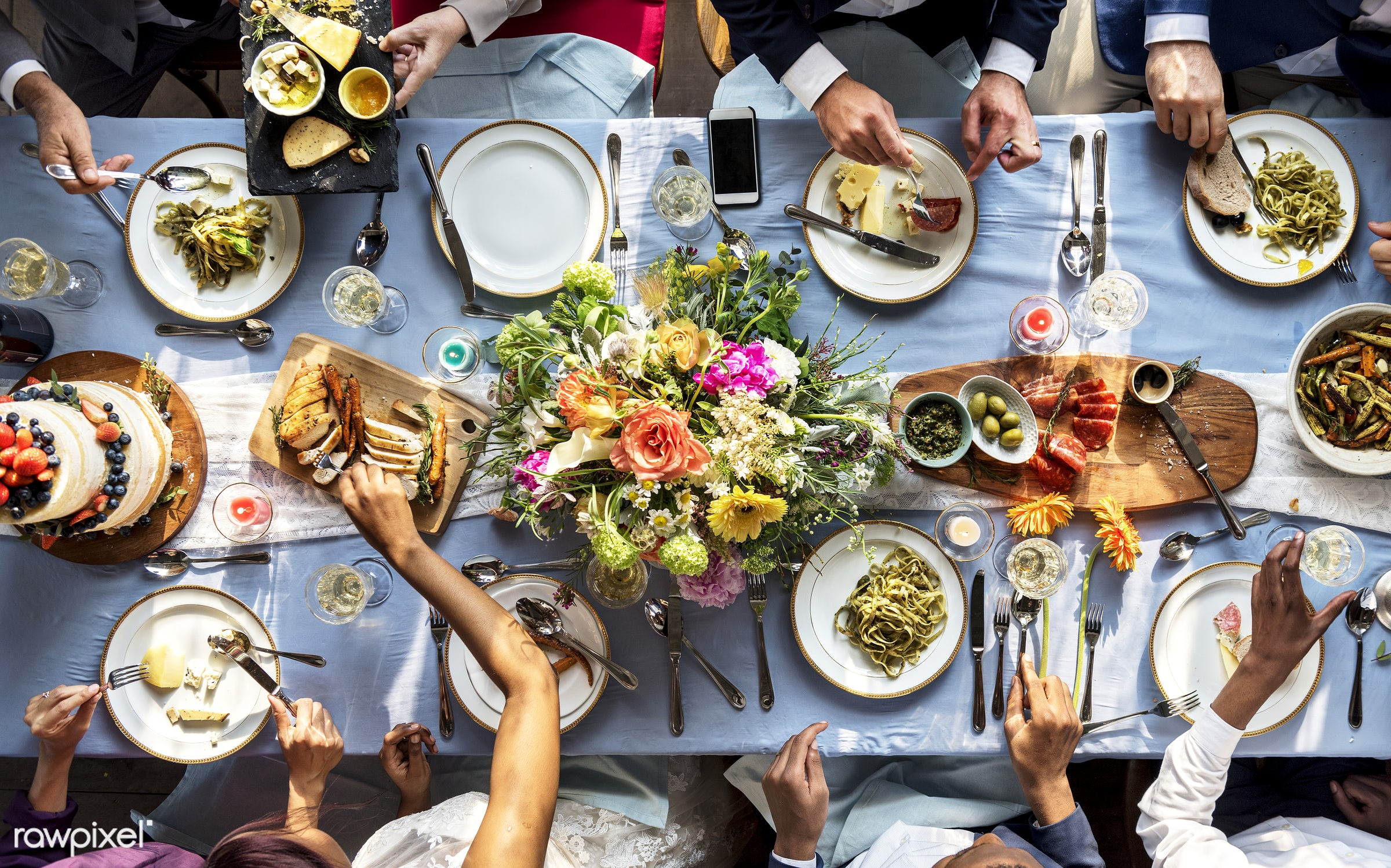 Aerial view of a bridal party dining table - dinner, dining, aerial view, cake, celebration, eating, event, flowers, food,...