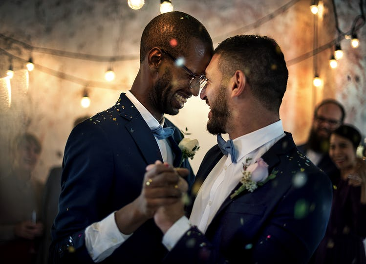 Gay couple dancing on wedding day