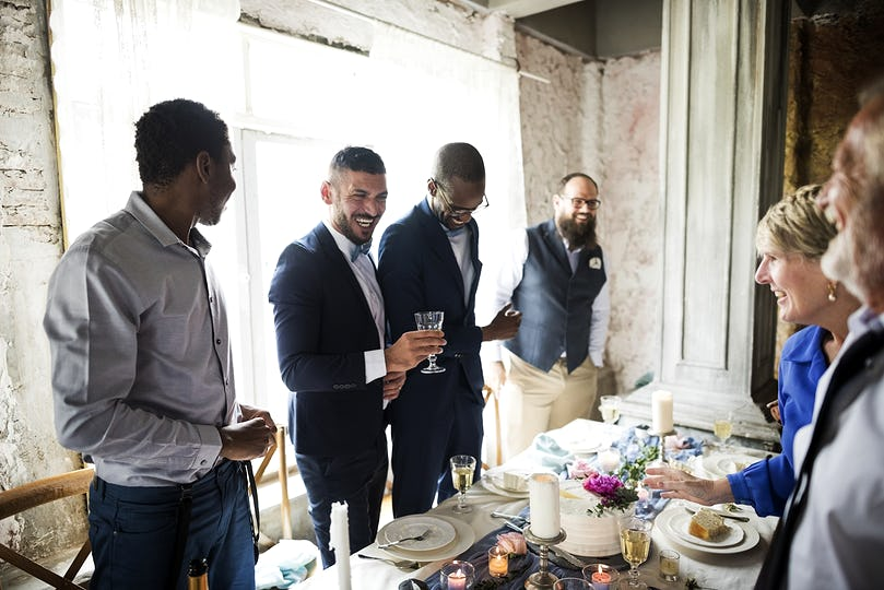 Group of Diverse Friends Gathering Together Wedding Reception