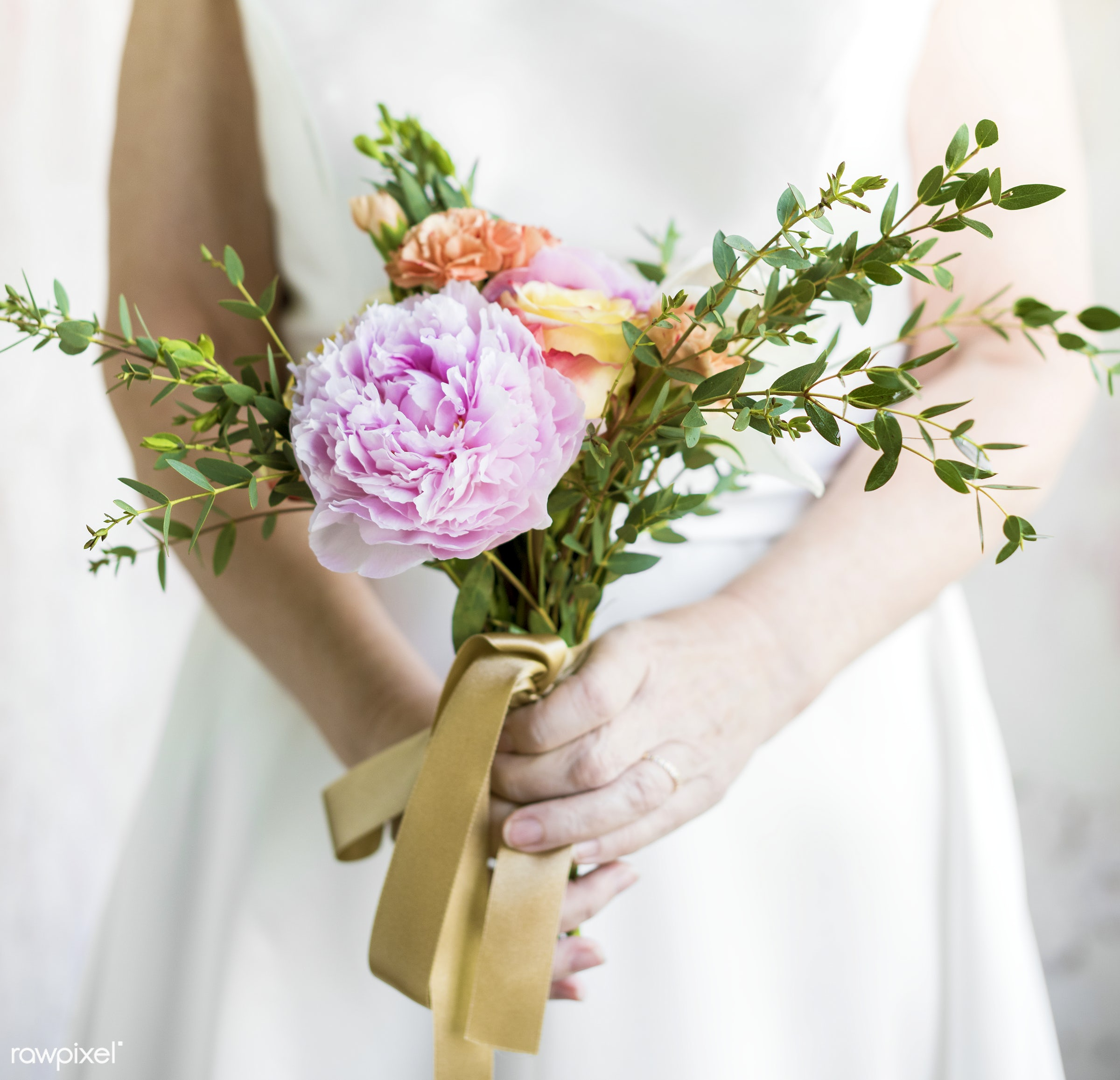 Bride holding a simple bouquet of flower - hands, body, closeup, flowers, leave, bouquet, simple, holding, bride, gown,...