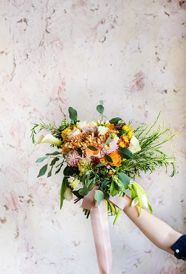 Hand Holding Fresh Real Flowers Bouquet