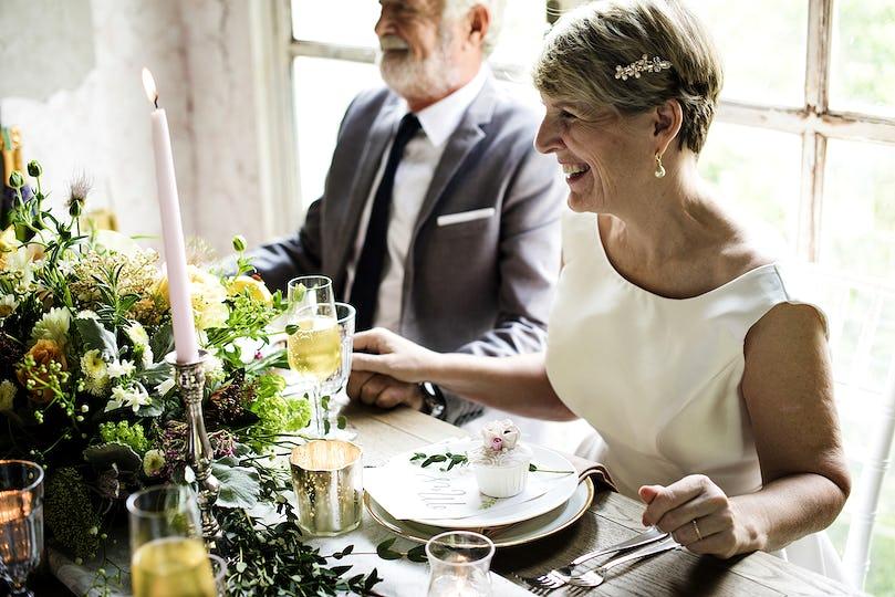 Senior Couple Sitting Cheerful Together Anniversary Celebration
