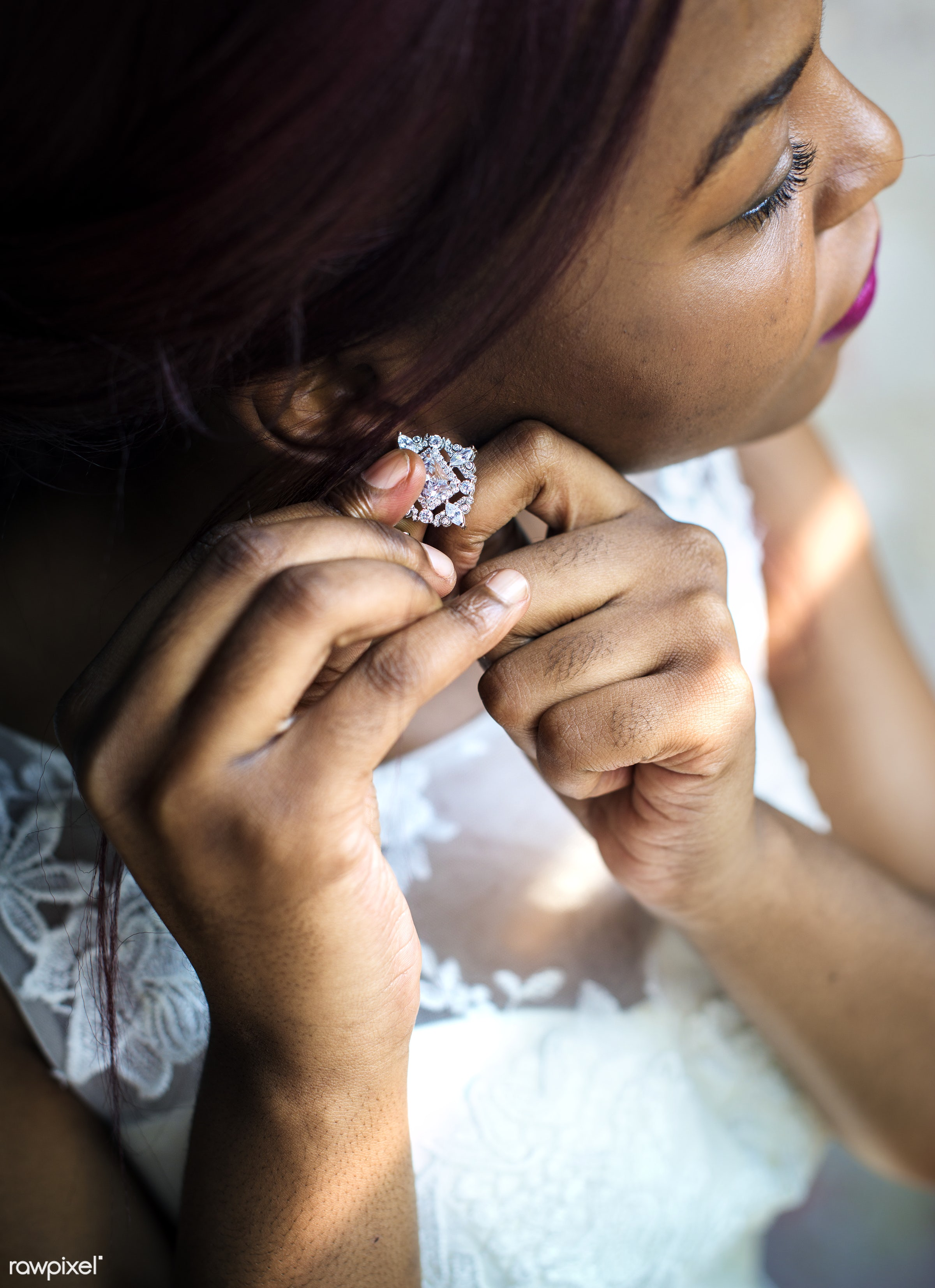 Black bride putting on earrings on her wedding day - jewelry, earring, bride, accessories, black, bling, closeup, event,...