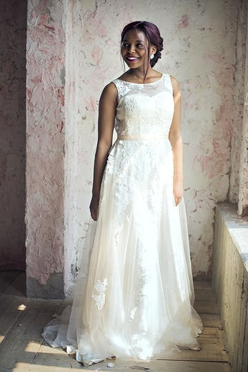 African Descent Bride in White Wedding Dress Cheerful