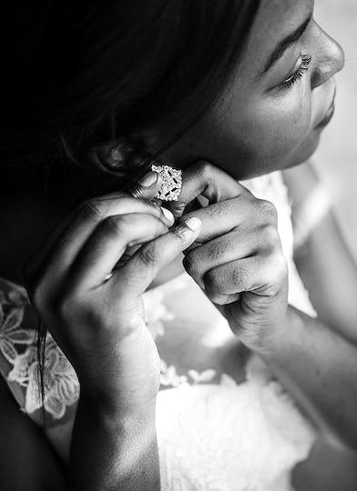 Bride Wearing Earrings on Wedding Ceremony Preparation
