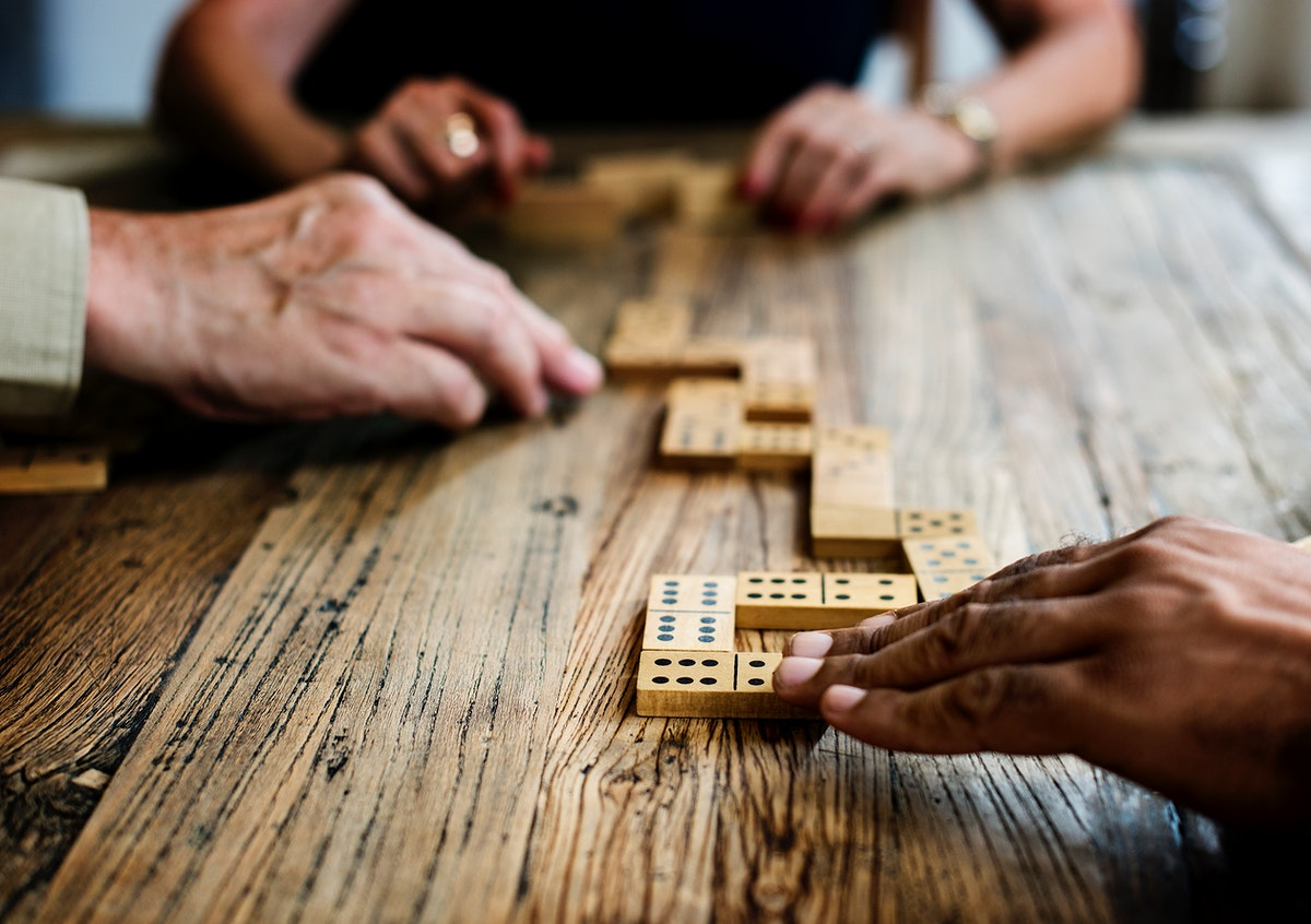 Group of people playing dominoes
