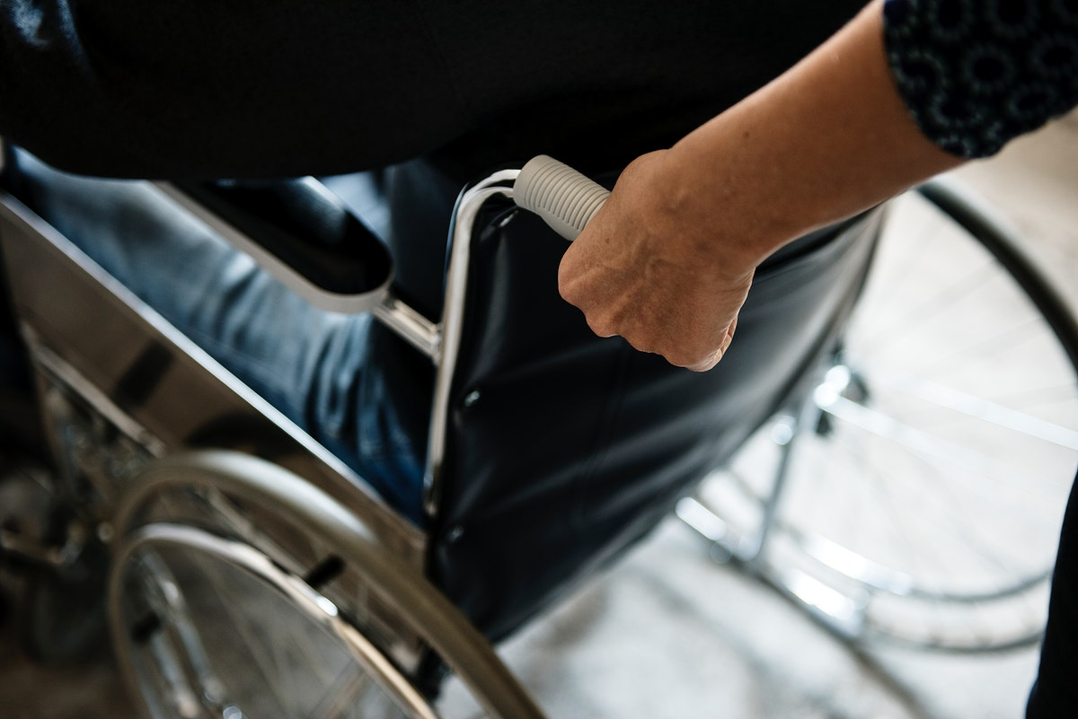 Closeup of a hand on wheelchair handle