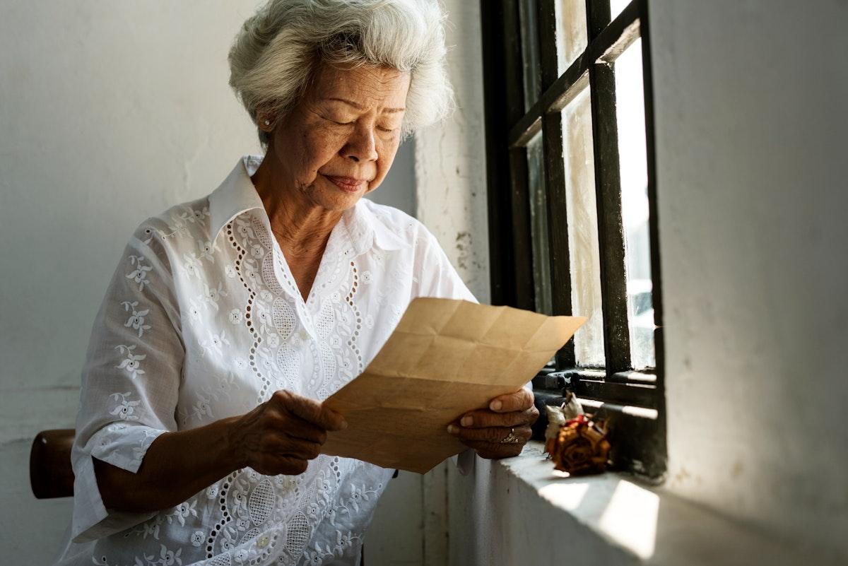 Elderly woman reading a letter